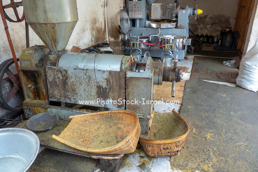 Electric spice milling machine. Photographed near Shaxi, Jianchuan County, Dali Prefecture, Yunnan province, China