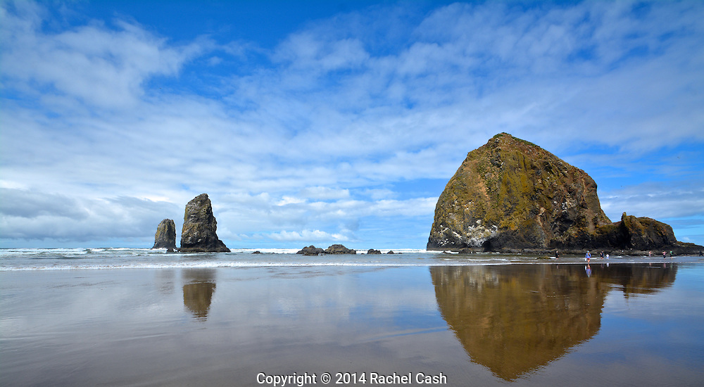 Haystack Rock is reflected in the tides at Oregon's Cannon Beach
