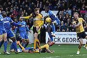 Karleigh Osborne of AFC Wimbledon and Mark Roberts (captain) of Cambridge United tussles during the Sky Bet League 2 match between Cambridge United and AFC Wimbledon at the R Costings Abbey Stadium, Cambridge, England on 2 January 2016. Photo by Stuart Butcher.