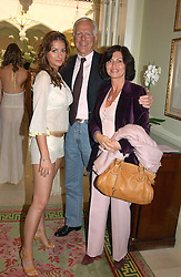 Left to right, SASKIA BOXFORD and her parents MICHAEL & PILAR BOXFORDat a fashion show of Sybil Stanislaus Summer 2005 collection with jewellery by Philippa Holland held at The Lanesborough Hotel, Hyde Park Corner, London on 13th April 2005.<br /><br />NON EXCLUSIVE - WORLD RIGHTS