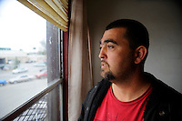Josh Holland looks out onto Lake Street from the second floor of a hotel in the area. Before the sweep, he and his partner were part of the Tents By The Gardens homeless community that had both sanitation and security. While he is grateful to be inside, he is the exception - they pay around $400 for a tiny room with shared facilities down the hall.
