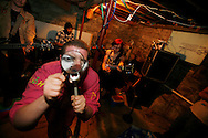 "Shane, of Cyn Cyn and the Pons, of Wisconsin, performs in the basement of ""House Gone Wylie."""