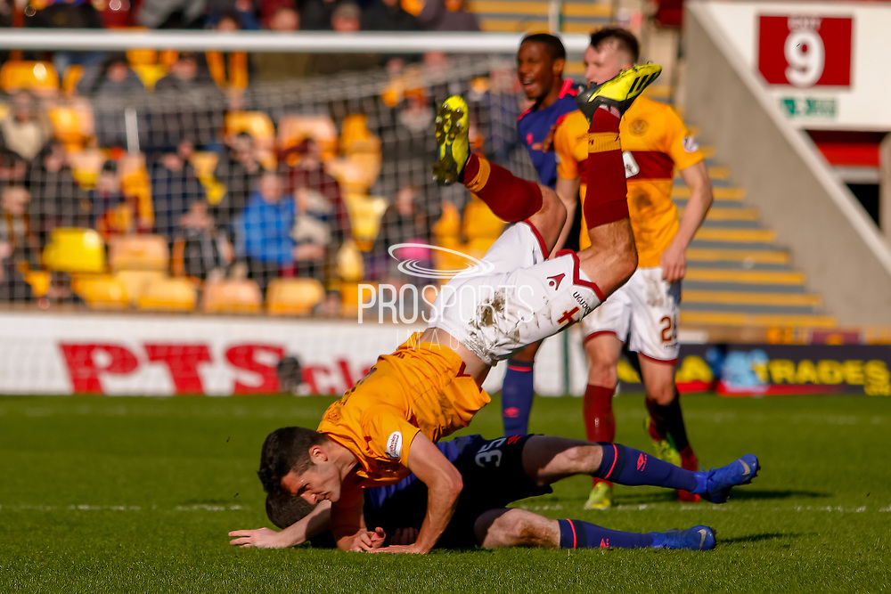 a strong ariel challenge leaves both Carl McHugh of Motherwell and Peter Haring of Hearts in a heap during the Ladbrokes Scottish Premiership match between Motherwell and Heart of Midlothian at Fir Park, Motherwell, Scotland on 17 February 2019.