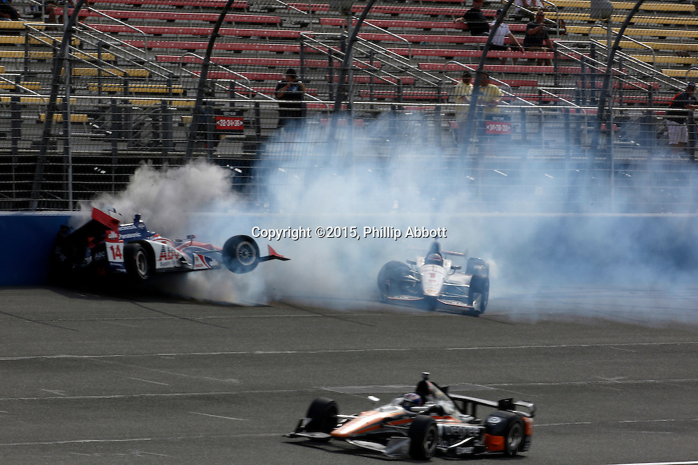 26-27 June, 2015, Fontana, California USA<br /> Takuma Sato and Will Power crash on the front straight<br /> &copy;2015, Phillip Abbott<br /> LAT Photo USA