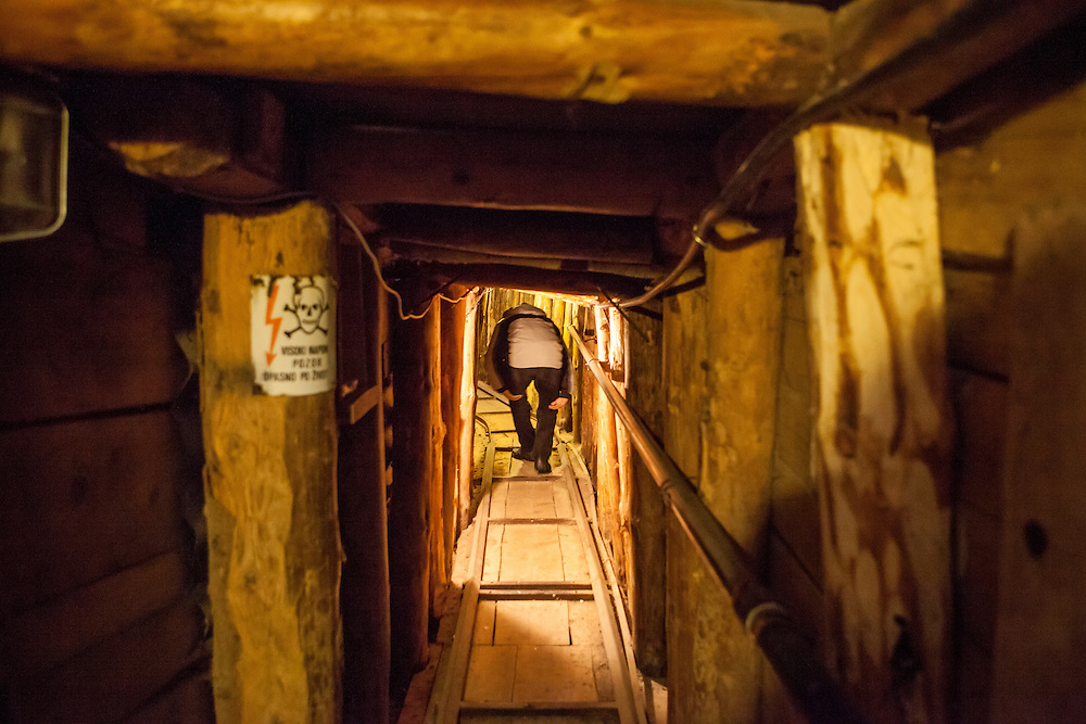 Former refugee Elvis Causevic in the Sarajevo Tunnel, also known as Tunel spasa (English: Tunnel of rescue) and Tunnel of Hope, which was an underground tunnel constructed between March and June 1993 during the Siege of Sarajevo in the midst of the Bosnian War. It was built by the Bosnian Army in order to link the city of Sarajevo, which was entirely cut off by Serbian forces, with Bosnian-held territory on the other side of the Sarajevo Airport, an area controlled by the United Nations. The tunnel linked the Sarajevo neighbourhoods of Dobrinja and Butmir, allowing food, war supplies, and humanitarian aid to come into the city, and allowing people to get out. The tunnel became a major way of bypassing the international arms embargo and providing the city defenders with weaponry.
