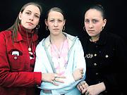 Three girls wearing earings and rings