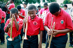 29 August 2014. Lower 9th Ward, New Orleans, Louisiana.<br /> Hurricane Katrina memorial 9 years later. <br /> L/R; Imaad Mays (10 yrs) and Sidney August (11 yrs) and Yusef Umranilz (12 yrs) from the Martin Luther King Jr Charter High School band say a prayer for victims at the official memorial in remembrance of the day Hurricane Katrina swamped the community.<br /> Photo; Charlie Varley/varleypix.com