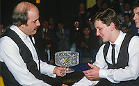 Jason Prince, 15 years, from N Ireland, receives tropy from Willy Thorne, England, on winning the BTNI sponsored N Ireland Youth Snooker Championship. 19860304JP+WT..Copyright Image from Victor Patterson, 54 Dorchester Park, Belfast, UK, BT9 6RJ..Tel: +44 28 9066 1296.Mob: +44 7802 353836.Voicemail +44 20 8816 7153.Skype: victorpattersonbelfast.Email: victorpatterson@mac.com.Email: victorpatterson@ireland.com (back-up)..IMPORTANT: If you wish to use this image or any other of my images please go to www.victorpatterson.com and click on the Terms & Conditions. Then contact me by email or phone with the reference number(s) of the image(s) concerned.