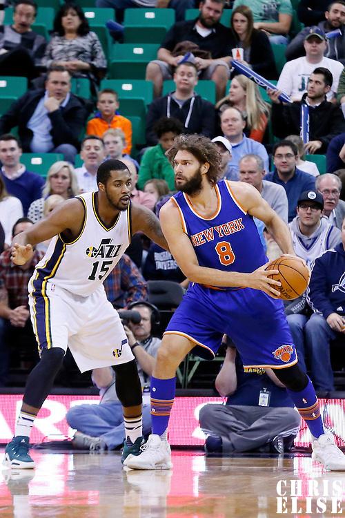 09 December 2015: Utah Jazz forward Derrick Favors (15) defends on New York Knicks center Robin Lopez (8) during the Utah Jazz 106-85 victory over the New York Knicks, at the Vivint Smart Home Arena, Salt Lake City, Utah, USA.