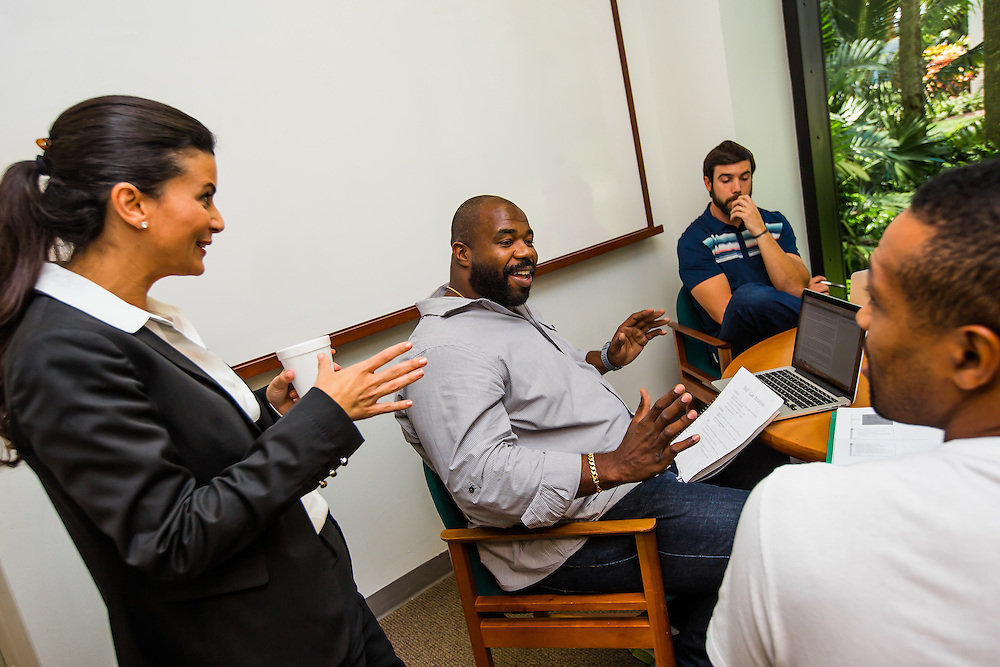 MIAMI, FL - June 24, 2015 -- Former NFL player Gerard Warren, left, and quarterback Trent Edwards participate in a Legal & Ethical Implications of Executive Decision Making class taught by Professor Patricia Abril at the University of Miami as part of their Miami Executive MBA for Artists & Athletes program on Wednesday, June 24, 2015.  (PHOTO / CHIP LITHERLAND)