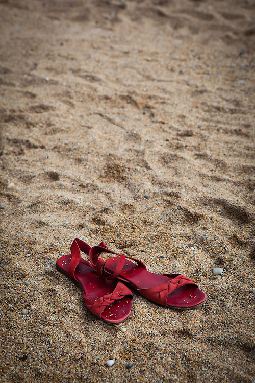 "Red sandals lying on a beach This mage can be licensed via Millennium Images. Contact me for more details, or email mail@milim.com For prints, contact me, or click ""add to cart"" to some standard print options."