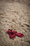 """Red sandals lying on a beach This mage can be licensed via Millennium Images. Contact me for more details, or email mail@milim.com For prints, contact me, or click """"add to cart"""" to some standard print options."""