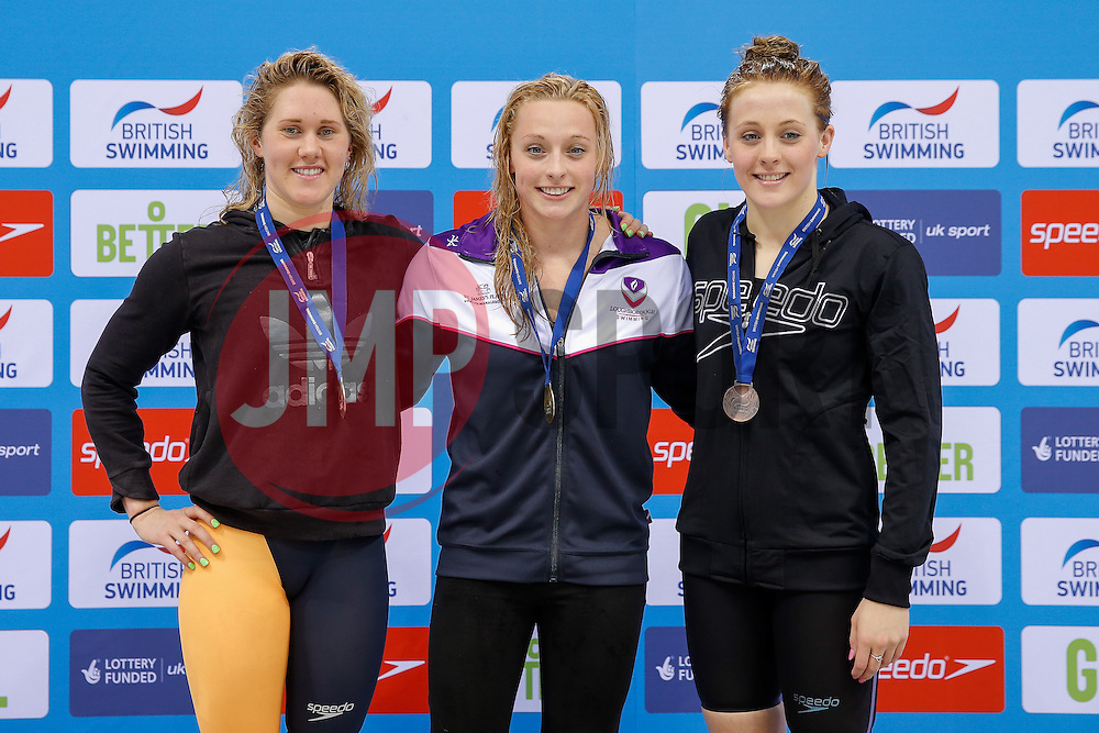 Rachael Kelly of Loughbrough University (C) celebrates on the podium after winning the Womens 100m Butterfly Final  - Photo mandatory by-line: Rogan Thomson/JMP - 07966 386802 - 16/04/2015 - SPORT - SWIMMING - The London Aquatics Centre, England - Day 4 - British Swimming Championships 2015.