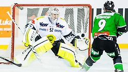 24.12.2014, Republic Square, Ljubljana, SLO, EBEL, HDD Telemach Olimpija Ljubljana vs EC Dornbirn, 30. Runde, in picture Nathan Lawson (EC Dornbirn, #52) and Hunter Bishop (HDD Telemach Olimpija, #9) during the Erste Bank Icehockey League 30. Round between HDD Telemach Olimpija Ljubljana and EC Dornbirn on Republic Square, Ljubljana, Slovenia on 2014/12/16. Photo by Urban Urbanc / Sportida