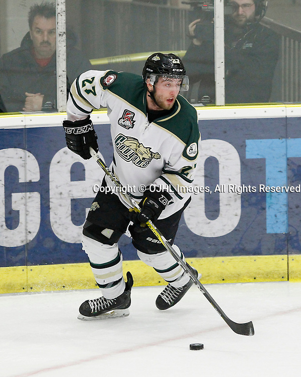 COBOURG, ON  - MAR 25,  2017: Ontario Junior Hockey League, playoff game between the Cobourg Cougars and the Wellington Dukes. Brennan Roy #27 of the Cobourg Cougars skates with the puck during the first period.<br /> (Photo by Tim Bates / OJHL Images)