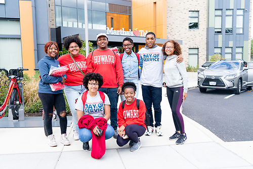 A group of Homecoming Day of Service participants standing outside of Martha's Table, a non-profit organization that provides education and nutrition services.
