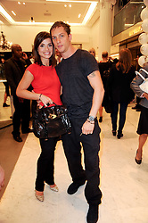 TOM HARDY and CHARLOTTE RILEY at the Mulberry outlet in Selfridge's, Oxford Street as part of Fashion's Night Out held around London on 8th September 2010.
