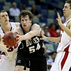 Mar 24, 2011; New Orleans, LA; Butler Bulldogs forward Matt Howard (54) is fouled by Wisconsin Badgers forward Jon Leuer (30) and guard Josh Gasser (21) during the second half of the semifinals of the southeast regional of the 2011 NCAA men's basketball tournament at New Orleans Arena. Butler defeated Wisconsin 61-54.  Mandatory Credit: Derick E. Hingle
