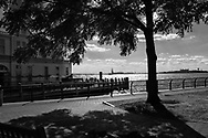 The New York Harbor and Pier 1 seen from Robert F. Wagner Jr. Park,