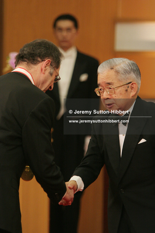 American musician Steve Reich (on left) shakes hands with Prince Hitachi (brother of the Japanese Emperor) after receiving his medal as laureate of the 2006 Praemium Imperiale art awards, in Meiji-Jingu Kinenkan hall, Tokyo, Japan, on Wednesday, Oct. 18,  2006. The five laureates in 2006 were internationally renowned Japanese artist Kusama Yayoi, French sculptor Christian Boltanski, German architect Frei Otto, American musician Steve Reich, and Russian dancer ballerina Maya Plisetskaya. All receive an honorarium of 15 million Yen, and a medal. The Japan Art Association, giver of the awards, is the oldest cultural foundation in Japan, established in 1887. The laureates are chosen each year by an international jury, from a list of nominees put forward by advisors. The awards are held annually in Tokyo in the presence of Prince and Princess Hitachi.