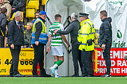 Ryan Christie (#17) of Celtic FC is ushered up the tunnel after being shown a straight red card during the Ladbrokes Scottish Premiership match between Livingston FC and Celtic FC at The Tony Macaroni Arena, Livingston, Scotland on 6 October 2019.