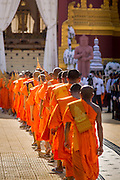 "04 FEBRUARY 2013 - PHNOM PENH, CAMBODIA: Cambodian Buddhist monks file into the cremation venue for the cremation of King-Father Norodom Sihanouk in Phnom Penh. Norodom Sihanouk (31 October 1922 - 15 October 2012) was the King of Cambodia from 1941 to 1955 and again from 1993 to 2004. He was the effective ruler of Cambodia from 1953 to 1970. After his second abdication in 2004, he was given the honorific of ""The King-Father of Cambodia."" Sihanouk died in Beijing, China, where he was receiving medical care, on Oct. 15, 2012.    PHOTO BY JACK KURTZ"