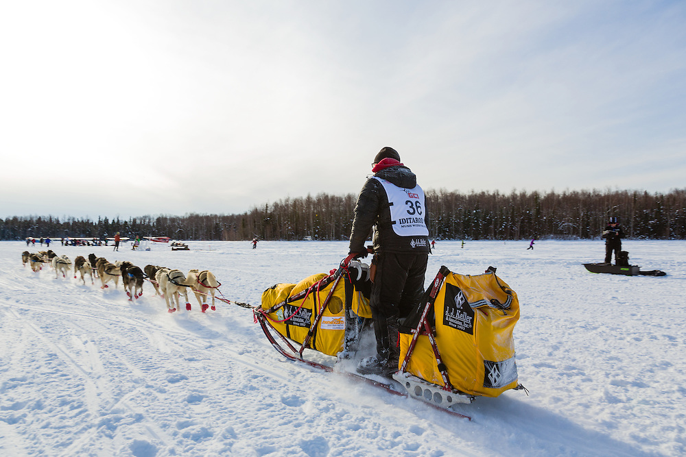 Musher Mitch Seavey competing in the 41st Iditarod Trail Sled Dog Race on Long Lake after leaving the Willow Lake area at the restart in Southcentral Alaska.  Afternoon.