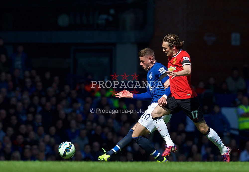 LIVERPOOL, ENGLAND - Sunday, April 26, 2015: Everton's Ross Barkley in action against Manchester United's Daley Blind during the Premier League match at Goodison Park. (Pic by David Rawcliffe/Propaganda)