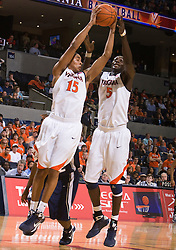 Virginia guard Sylven Landesberg (15) and center Assane Sene (5) grabs a rebound against Xavier.  The #22 ranked Xavier Musketeers defeated the Virginia Cavaliers 84-70 at the John Paul Jones Arena on the Grounds of the University of Virginia in Charlottesville, VA on January 3, 2009.