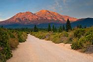 Dirt road below Mount Shasta Volcano at sunset, Cascade Range, Siskiyou County, California