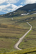 View of the Park Road as it crosses the tundra at Stony Hill Overlook in Denali National Park Alaska. Denali National Park and Preserve encompasses 6 million acres of Alaska's interior wilderness.
