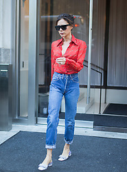Victoria Beckham is seen leaving her New York Hotel wearing a red blouse and blue jeans. 15 Sep 2017 Pictured: Victoria Beckham. Photo credit: TM / MEGA TheMegaAgency.com +1 888 505 6342