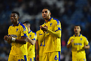 Terell Thomas (6) of AFC Wimbledon applauds the travelling fans at full time after a 2-1 loss to Portsmouth during the EFL Sky Bet League 1 match between Portsmouth and AFC Wimbledon at Fratton Park, Portsmouth, England on 1 January 2019.