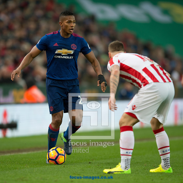 Luis Antonio Valencia of Manchester United (left) looks to find a way past Marko Arnautovic of Stoke City during the Premier League match at the Bet 365 Stadium, Stoke-on-Trent<br /> Picture by Russell Hart/Focus Images Ltd 07791 688 420<br /> 21/01/2017