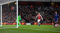 Football - 2018 / 2019 Premier League - Arsenal vs. Chelsea<br /> <br /> Laurent Koscielny (Arsenal FC) watches as his effort loops over Kepa Arrizabalaga (Chelsea FC) to give his team a two goal lead at The Emirates.<br /> <br /> COLORSPORT/DANIEL BEARHAM
