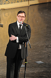 Jon Hodgman, arms still folded, warming up an already warm crowd for Century on a Spree: The Whiffenpoof Centennial (1909-2009)