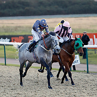 Gabrial's Gift and Jamie Spencer winning the 3.10 race