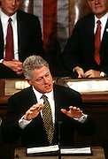 US President Bill Clinton State of the Union address to Congress January 27, 1998 in Washington, DC as Vice President Al Gore and Speaker of the House Newt Gingrich look on.
