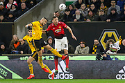 Manchester United Midfielder Nemanja Matic battles for header with Wolverhampton Wanderers midfielder Romain Saiss (27) during the The FA Cup match between Wolverhampton Wanderers and Manchester United at Molineux, Wolverhampton, England on 16 March 2019.