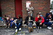 "Every Sunday Rev.Lee Anne Reat hold a church service on the corner of Central Ave and Broad street. Each week dozens of people living in the ""Bottoms"" gather for prayer and food."