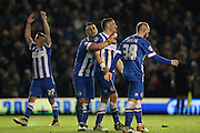 Brighton striker, Tomer Hemed (10) celebrates scoring his third goal of the game with team mate Brighton central midfielder, Beram Kayal (7) during the Sky Bet Championship match between Brighton and Hove Albion and Fulham at the American Express Community Stadium, Brighton and Hove, England on 15 April 2016.