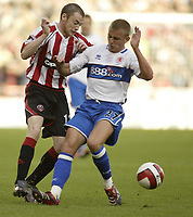 Photo: Aidan Ellis.<br /> Sheffield United v Middlesbrough. The Barclays Premiership. 30/09/2006.<br /> Sheffield's Alan Quinn (L) battles with Boro's Lee Catermole