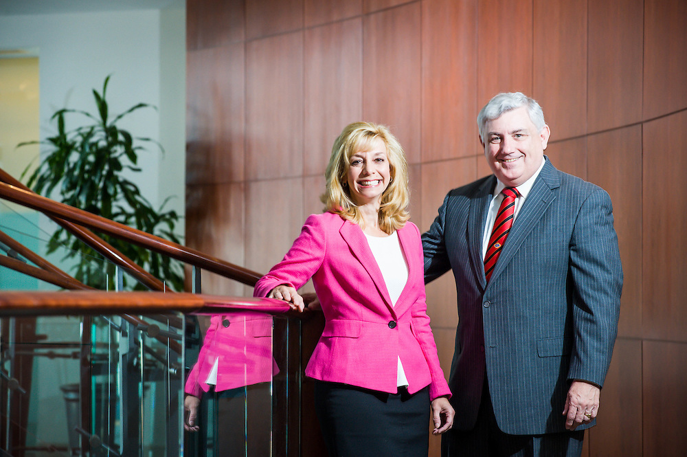 NE Moves President Bill Mullin with Mass Housing Business Development Officer Lisa Fiandaca photographed in NE Moves offices in Waltham, MA.
