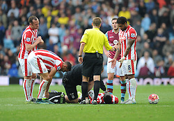 Mame Biram Diouf of Stoke City receives medical treatment. - Mandatory byline: Alex James/JMP - 07966 386802 - 03/10/2015 - FOOTBALL - Villa Park - Birmingham, England - Aston Villa v Stoke City - Barclays Premier League