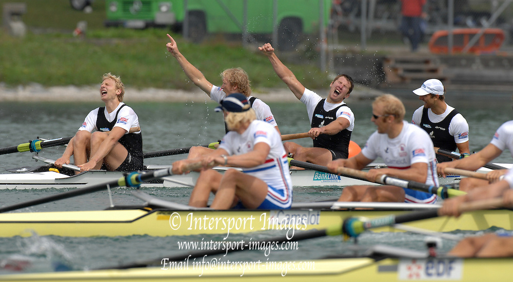 Munich, GERMANY, NZL M4- Celebrate winning the Men's Coxless Fours Left ot right , Stroke, Hamish BOND, Eric MURRAy, James DILLINGER and Bow Carl MEYER, during the 2007 World Rowing Championships on the Munich Olympic Regatta Course 24/08/2007 [Mandatory Credit. Peter Spurrier/Intersport Images]..... , Rowing Course, Olympic Regatta Rowing Course, Munich, GERMANY