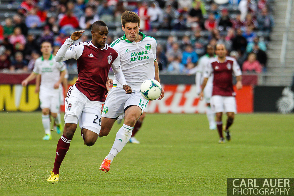 March 30th, 2013 Commerce City, CO - Colorado Rapids forward Deshorn Brown (26) and Portland Timbers defender David Horst (12) chase after the ball in the second half of the MLS match between the Portland Timbers and the Colorado Rapids at Dick's Sporting Goods Park in Commerce City, CO