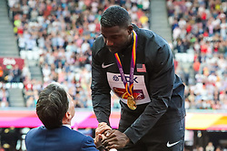London, 2017 August 06. Lord Coe presents Justin Gatlin with his gold medal for the men's 100m on day three of the IAAF London 2017 world Championships at the London Stadium. © Paul Davey.