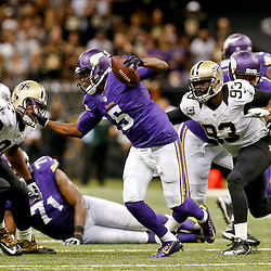 Sep 21, 2014; New Orleans, LA, USA; Minnesota Vikings quarterback Teddy Bridgewater (5) scrambles away from New Orleans Saints defensive end Cameron Jordan (94) and outside linebacker Junior Galette (93) during the second half of a game at Mercedes-Benz Superdome. The Saints defeated the Vikings 20-9. Mandatory Credit: Derick E. Hingle-USA TODAY Sports