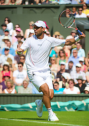 LONDON, ENGLAND - Monday, June 21, 2010: Alejandro Falla (COL) during the Gentleman's Singles 1st Round on day one of the Wimbledon Lawn Tennis Championships at the All England Lawn Tennis and Croquet Club. (Pic by David Rawcliffe/Propaganda)