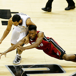 Jun 11, 2013; San Antonio, TX, USA; Miami Heat point guard Norris Cole (30) San Antonio Spurs point guard Cory Joseph (5) in the third quarter during game three of the 2013 NBA Finals at the AT&T Center. Mandatory Credit: Derick E. Hingle-USA TODAY Sports